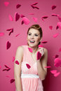 Beautiful young woman with hearts falling around valentine s day her Royalty Free Stock Images