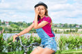 Beautiful young woman with her bicycle at the park Royalty Free Stock Photo