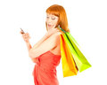 Beautiful young woman with her shopping bags Stock Photo