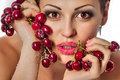 Beautiful young woman holding bunch red cherries covered sugar Royalty Free Stock Images