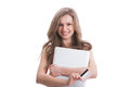 Beautiful young woman holding card and laptop Royalty Free Stock Photo