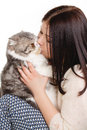 Beautiful young woman holding a cat, isolated against white background Royalty Free Stock Photo