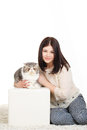 Beautiful young woman holding a cat, isolated against white background Royalty Free Stock Images
