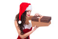 Beautiful young woman holding Christmas gift. Isolated on white