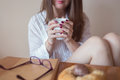 Beautiful young woman holding a cup of coffee in her hands Royalty Free Stock Photo