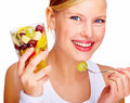 Beautiful young woman holding glass full of fruits Royalty Free Stock Image