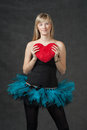 Beautiful young woman holding a heart shaped red ballet dancer weared tutu skirt with pillow in hands vertical shot of the Royalty Free Stock Photography