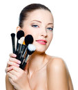 Beautiful young  woman  holding make-up brushes Stock Images