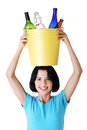 Beautiful young woman holding recycling bin Royalty Free Stock Photos