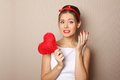 Beautiful young woman holding a red heart Stock Photography