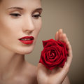 Beautiful young woman holding red rose hand Stock Images
