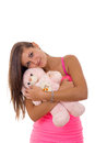 Beautiful young woman holding teddy bear and hugging him smiling Stock Image