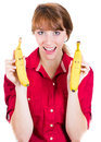 Beautiful young woman holding two funny banana close up portrait of a isolated on a white background nutrition and healthy life Royalty Free Stock Photography