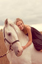 Beautiful young woman with a horse in the forest Royalty Free Stock Photo