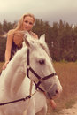 Beautiful young woman with a horse in the forest Stock Photos