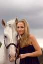 Beautiful young woman with a horse in the forest Royalty Free Stock Images