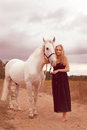 Beautiful young woman with a horse in the forest Royalty Free Stock Photos