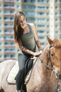 Beautiful young woman on horseback portrait of against green of summer park Stock Photography
