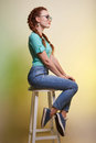 Beautiful young woman in jeans and sneakers Royalty Free Stock Photo