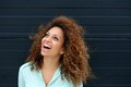 Beautiful young woman laughing outdoors and looking up portrait of a Royalty Free Stock Images