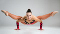 Beautiful young woman limber exerciser in the studio Royalty Free Stock Photos
