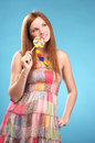 Beautiful young woman with lollipop Stock Images