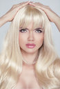 Beautiful young woman with long blond hair. Pretty model looking Royalty Free Stock Photo