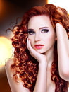 Beautiful young woman with long curly hairs portrait of a over bright night lights Royalty Free Stock Photos