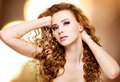 Beautiful young woman with long curly hairs portrait of a over bright night lights Stock Images