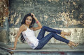 Beautiful young woman long dark hair wearing denim jeans Royalty Free Stock Photography