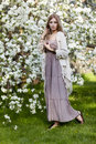 Beautiful young woman in long dress boho style on green grass un Royalty Free Stock Photo