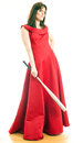 Beautiful young woman long red dress standing white background holding metal baseball bat Royalty Free Stock Photo