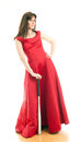 Beautiful young woman long red dress standing white background holding metal baseball bat Royalty Free Stock Image