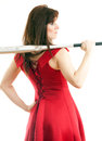 Beautiful young woman long red dress standing white background holding metal baseball bat Royalty Free Stock Photography