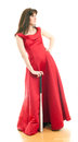 Beautiful young woman long red dress standing white background holding metal baseball bat Royalty Free Stock Images