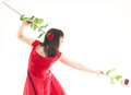 Beautiful young woman long red dress standing white background holding red rose Stock Images