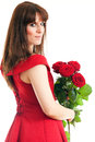 Beautiful young woman long red dress standing white background holding red rose Royalty Free Stock Photography