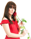 Beautiful young woman long red dress standing white background holding red rose Royalty Free Stock Images