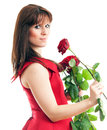 Beautiful young woman long red dress standing white background holding red rose Stock Photography
