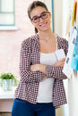Beautiful young woman looking at camera in the office portrait of Royalty Free Stock Images