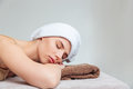 Beautiful young woman lying with eyes closed in spa salon Royalty Free Stock Photo