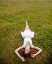 beautiful young woman lying in the field and relaxing Royalty Free Stock Photo