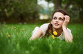 Beautiful young woman lying in green grass Royalty Free Stock Photo