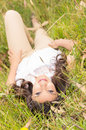 Beautiful young woman lying on green grass Royalty Free Stock Photo