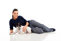Beautiful young woman lying her dog isolated white Royalty Free Stock Images