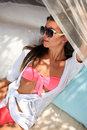 Beautiful young woman lying on sun lounger Royalty Free Stock Photos
