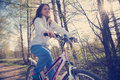 Beautiful young woman with mountain bicycle