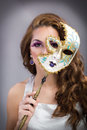 Beautiful young woman with mysterious venetian mask beauty model girl carnival Stock Images