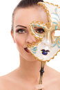 Beautiful young woman with mysterious venetian mask beauty model girl carnival Royalty Free Stock Photography