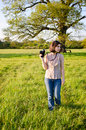 Beautiful young woman nature photographer a out in taking photos Stock Photo